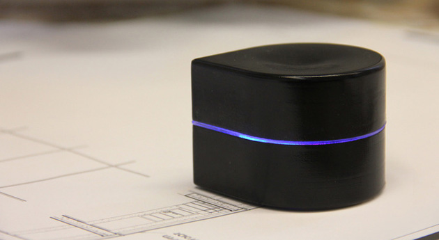 This robot printer runs around the page laying down ink.